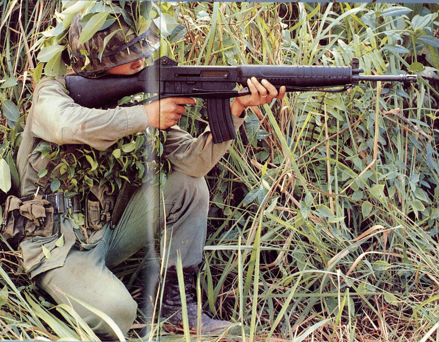 Soldier holding SAR 80 assault rifle